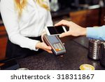 paying with smartphone. closeup ... | Shutterstock . vector #318311867