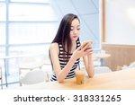 chinese pretty girl  sitting... | Shutterstock . vector #318331265