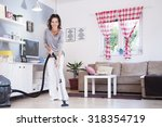 woman with vacuum cleaner.... | Shutterstock . vector #318354719