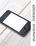 smart phone on wooden planks.   Shutterstock . vector #318362609