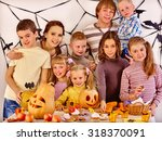 family on halloween party with... | Shutterstock . vector #318370091