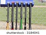 Baseball bats hanging outside the dugouts - stock photo