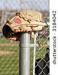 baseball mitt outside the dugouts area - stock photo