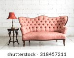 pink vintage sofa and lamp on...