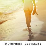 Beach Travel   Woman Walking O...