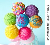 colorful cake pops tied with a... | Shutterstock . vector #318474071