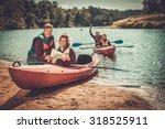 Group Of People On Kayaks...