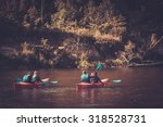 Group Of People On A Kayaks