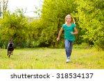 girl running away from dog or... | Shutterstock . vector #318534137
