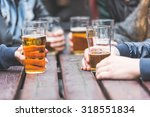 hands holding glasses with beer ... | Shutterstock . vector #318551834
