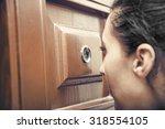 girl looking through the... | Shutterstock . vector #318554105