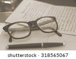 vintage glasses and pen   toned ... | Shutterstock . vector #318565067