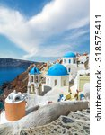 churches of oia village under... | Shutterstock . vector #318575411