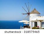 windmills of oia village ... | Shutterstock . vector #318575465