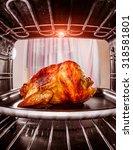 roast chicken in the oven  view ... | Shutterstock . vector #318581801