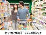 young couple shopping in a... | Shutterstock . vector #318585035