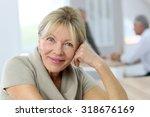 portrait of smiling senior... | Shutterstock . vector #318676169