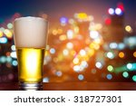 Glass Of Beer With Colorful...