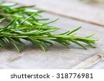 rosemary on a wooden background  | Shutterstock . vector #318776981