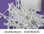 Small photo of cotton buds and absorbent cotton, selective focus