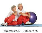 elderly couple exercising on a... | Shutterstock . vector #318807575