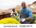 handsome african man gardening with his wife at home - stock photo