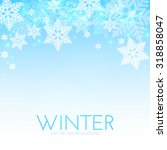 blue background with snowflakes....   Shutterstock .eps vector #318858047