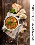 fresh lentil stew with sausages ... | Shutterstock . vector #318884387