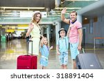 happy family with a suitcase at ... | Shutterstock . vector #318891404