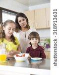 lovely mother and her children... | Shutterstock . vector #318913631
