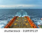 A Supply Boat Sailing Away Fro...