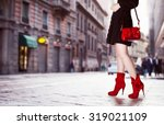 a girl with red bag and red... | Shutterstock . vector #319021109