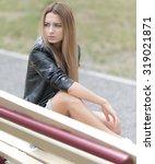 portrait of a beautiful girl   Shutterstock . vector #319021871