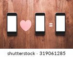 three smartphone on wooden... | Shutterstock . vector #319061285