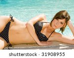 woman at the edge of a swimming ... | Shutterstock . vector #31908955