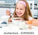 Little Girl Eating Chocolate...