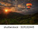hot air balloon over rice... | Shutterstock . vector #319132445