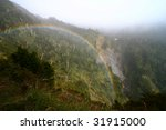 Rainbow in misty mountain, Taiwan - stock photo