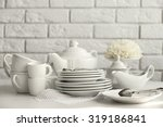 clean dishes on table on brick... | Shutterstock . vector #319186841