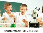 cute pupils doing biochemistry... | Shutterstock . vector #319211351