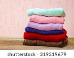pile of colorful warm clothes... | Shutterstock . vector #319219679