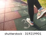 female model playing hopscotch... | Shutterstock . vector #319219901