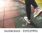 female model playing hopscotch... | Shutterstock . vector #319219901