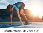 young male runner taking ready... | Shutterstock . vector #319221419