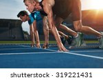 two young athletes at starting... | Shutterstock . vector #319221431