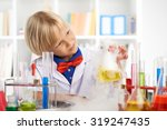 young chemist looking at the... | Shutterstock . vector #319247435
