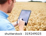 farmer using digital tablet in... | Shutterstock . vector #319249025