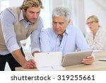 senior man attending business... | Shutterstock . vector #319255661