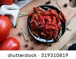 sun dried tomatoes   Shutterstock . vector #319310819