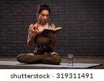 beautiful girl doing yoga... | Shutterstock . vector #319311491